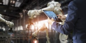 manager-industrial-engineer-using-tablet-check-control-automation-robot-arms-machine_34200-348.jpg